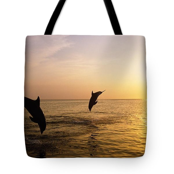 Silhouette Of Bottlenose Dolphins Tote Bag by Natural Selection Craig Tuttle