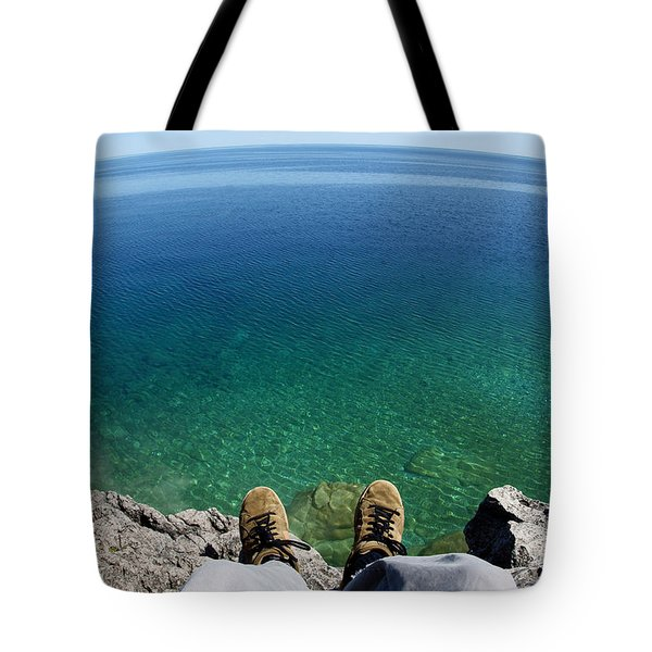 Sitting On A Cliff Tote Bag
