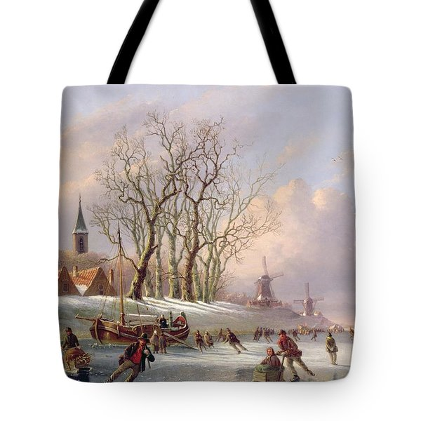 Skaters On A Frozen River Before Windmills Tote Bag by Dutch School
