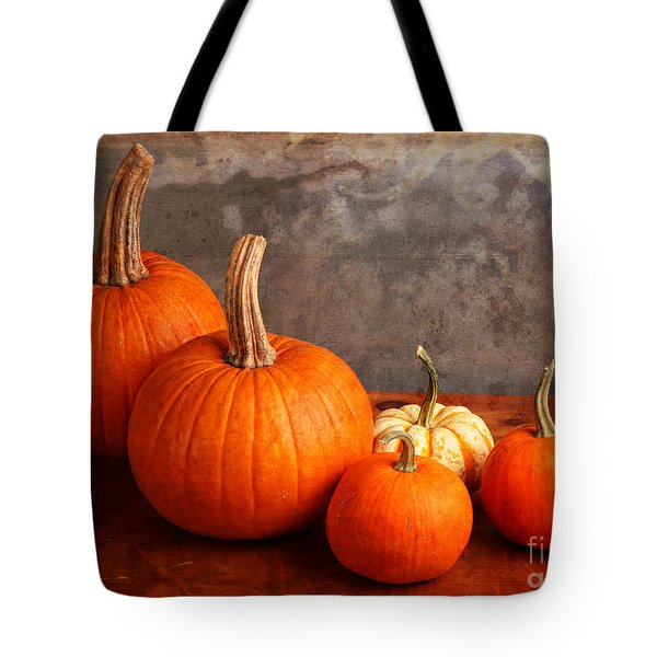 Tote Bag featuring the photograph Small Decorative Pumpkins by Verena Matthew