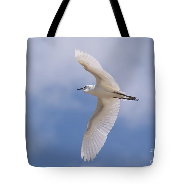 Tote Bag featuring the photograph Small Egret Flying Over The House by John  Kolenberg