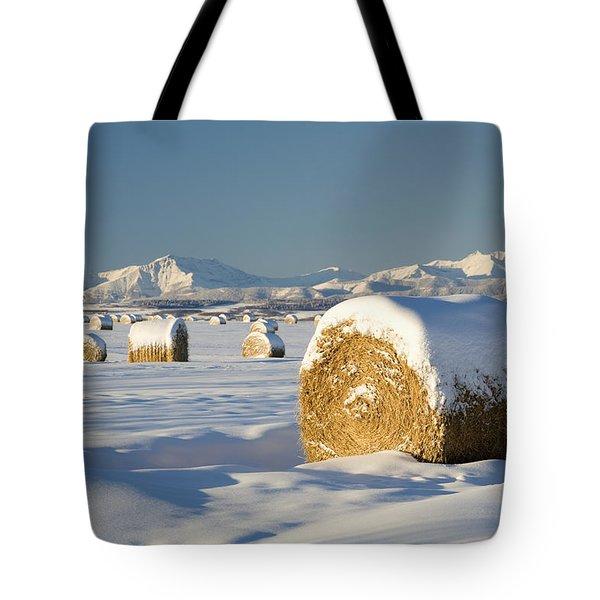 Snow-covered Hay Bales Okotoks Tote Bag by Michael Interisano