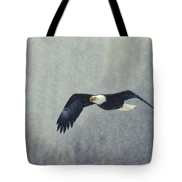 Tote Bag featuring the photograph Snow Flight by Myrna Bradshaw