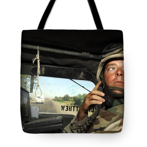 Soldier Monitors The Progress Of A 67 Tote Bag by Stocktrek Images