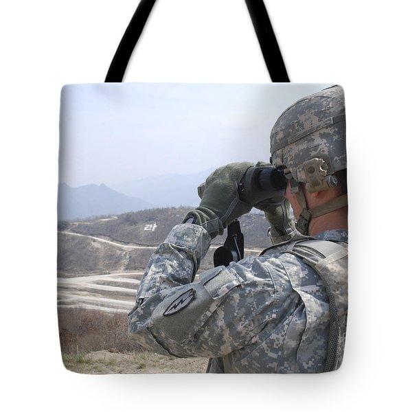 Soldier Observes An Adjust Fire Mission Tote Bag by Stocktrek Images