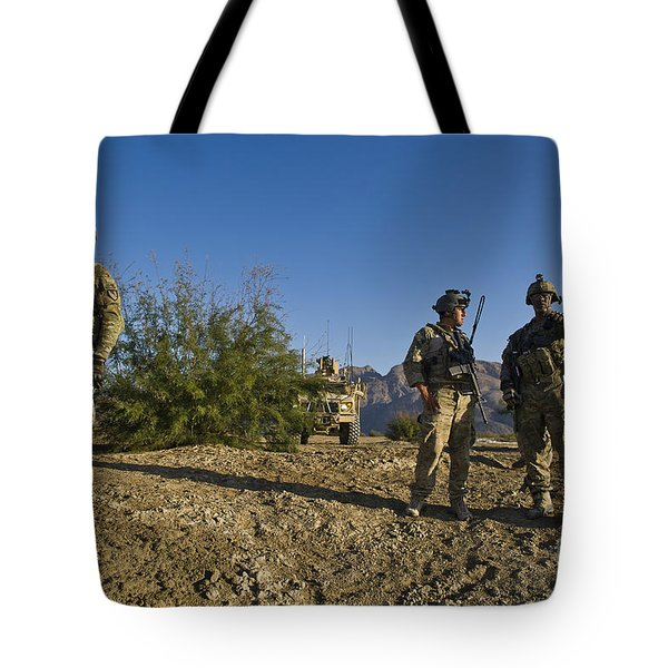 Soldiers Discuss A Strategic Plan Tote Bag by Stocktrek Images