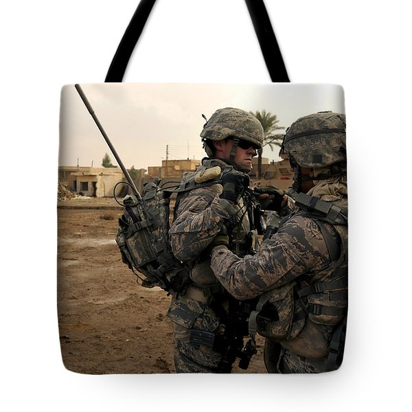 Soldiers Help One Another Tote Bag by Stocktrek Images