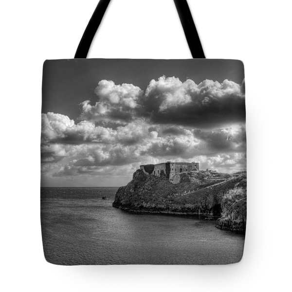 Tote Bag featuring the photograph St Catherines Rock Tenby by Steve Purnell