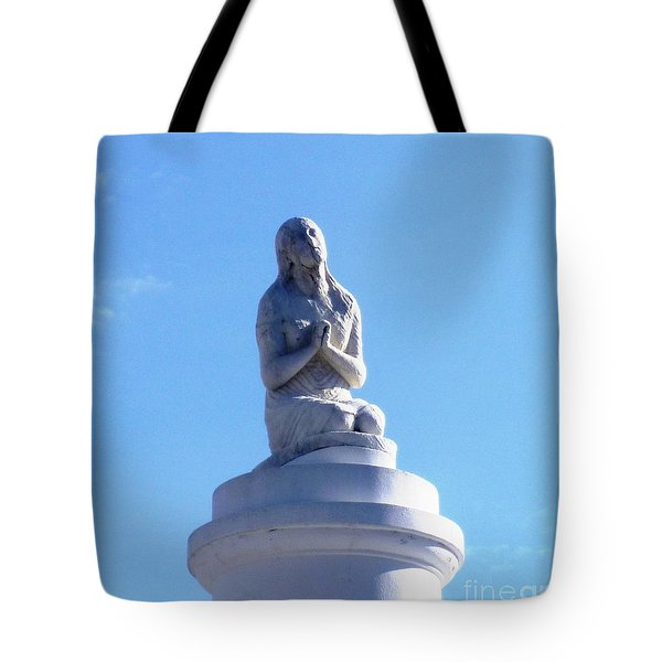 Tote Bag featuring the photograph St. Louis Cemetery Statue 1 by Alys Caviness-Gober
