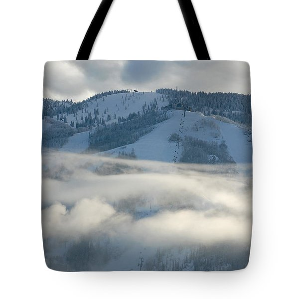 Tote Bag featuring the photograph Steamboat Ski Area In Clouds by Don Schwartz