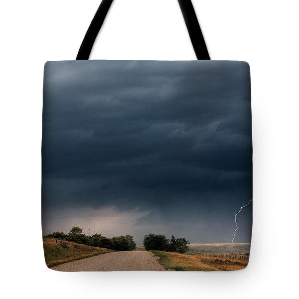 Storm Clouds And Lightning Along A Saskatchewan Country Road Tote Bag by Mark Duffy