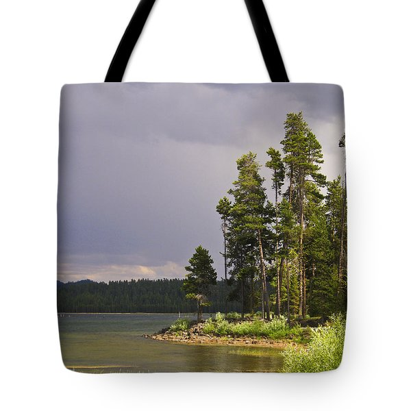 Storm Clouds Over A Lake Tote Bag by Anne Mott