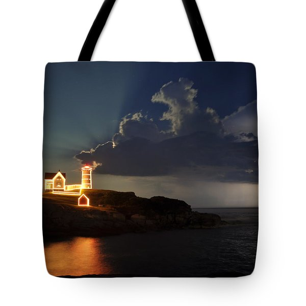 Storm Energizes The Lightning And The Lighthouse Tote Bag by Rick Frost