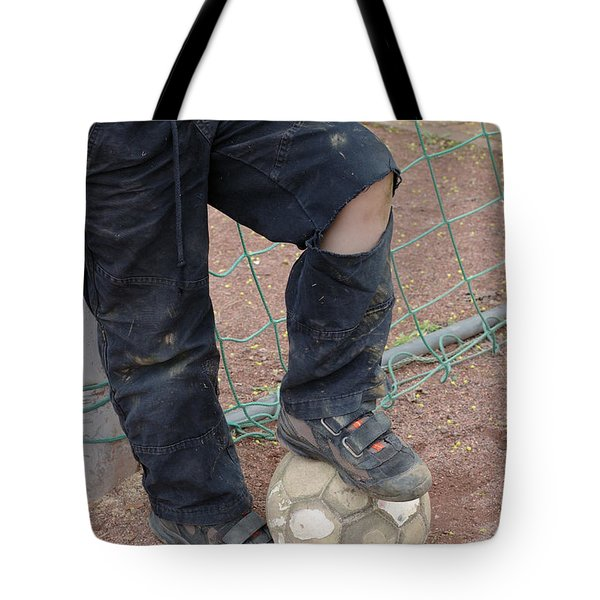 Street Soccer - Torn Trousers And Ball Tote Bag by Matthias Hauser
