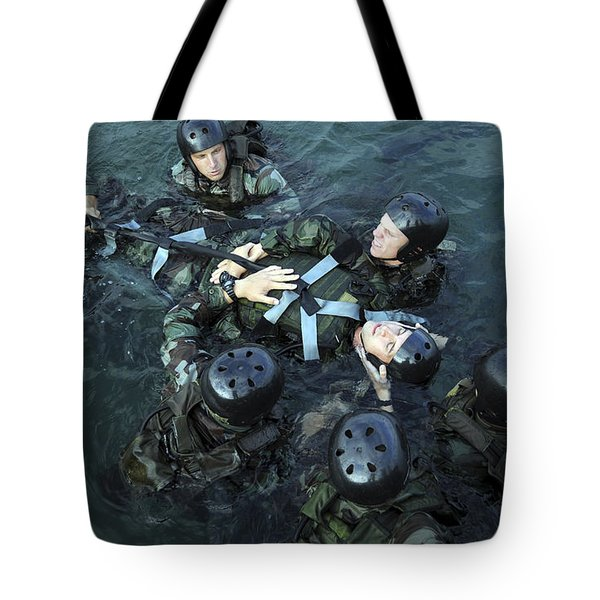 Students Secure A Simulated Casualty Tote Bag by Stocktrek Images
