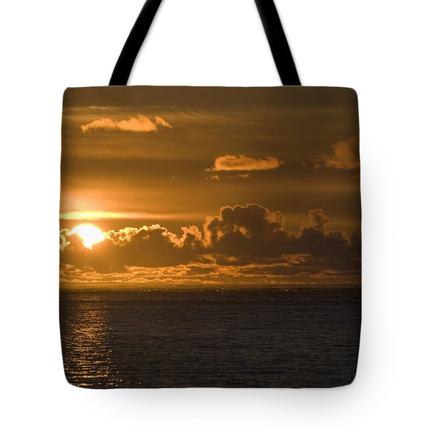 Sun Setting On The Ocean With The Tote Bag by Michael Interisano