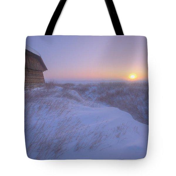 Sunrise On Abandoned, Snow-covered Tote Bag by Dan Jurak