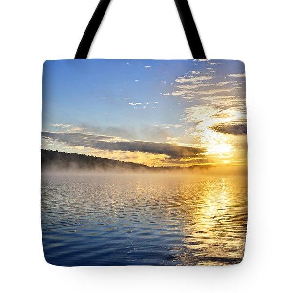 Sunrise On Foggy Lake Tote Bag