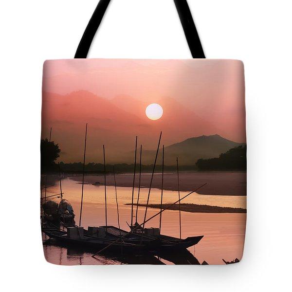 sunset at Mae Khong river Tote Bag by Setsiri Silapasuwanchai