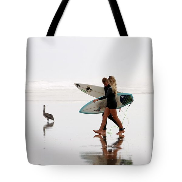 Tote Bag featuring the photograph Surfers And A Pelican by Alice Gipson