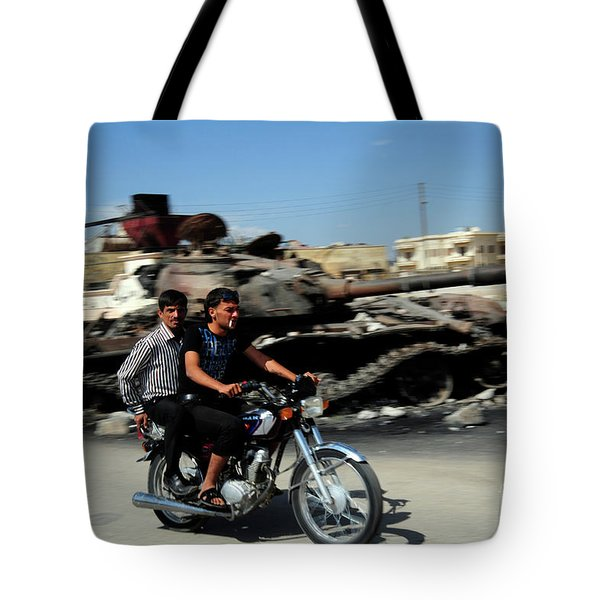Syrian Men Drive A Motorbike Tote Bag by Andrew Chittock
