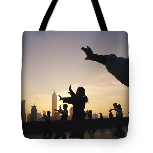 Tai Chi On The Bund In The Morning Tote Bag by Justin Guariglia