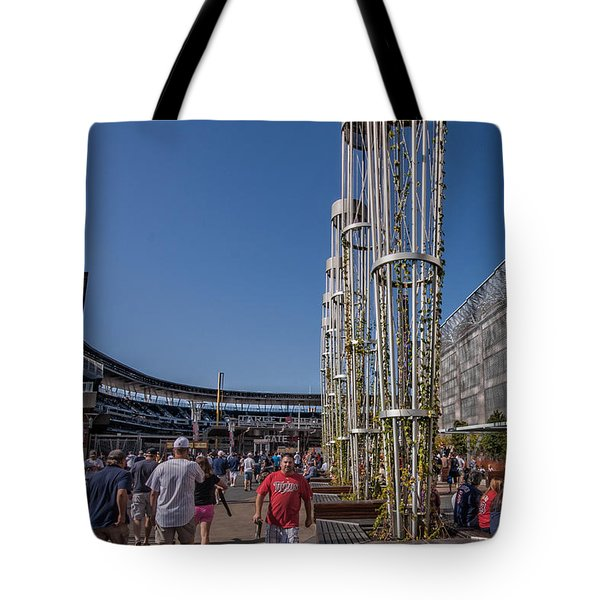 Tote Bag featuring the photograph Target Plaza by Tom Gort