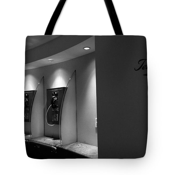 Tote Bag featuring the photograph Telephones On Wall by Nina Prommer
