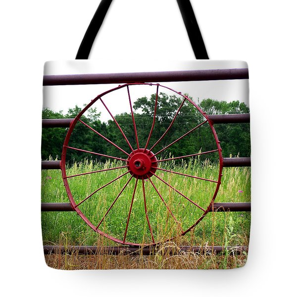 Tote Bag featuring the photograph Texas Wildflowers Through Wagon Wheel by Kathy  White
