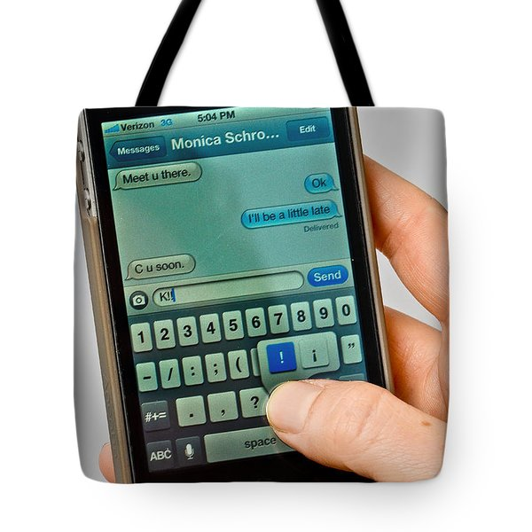 Texting On An Iphone Tote Bag by Photo Researchers