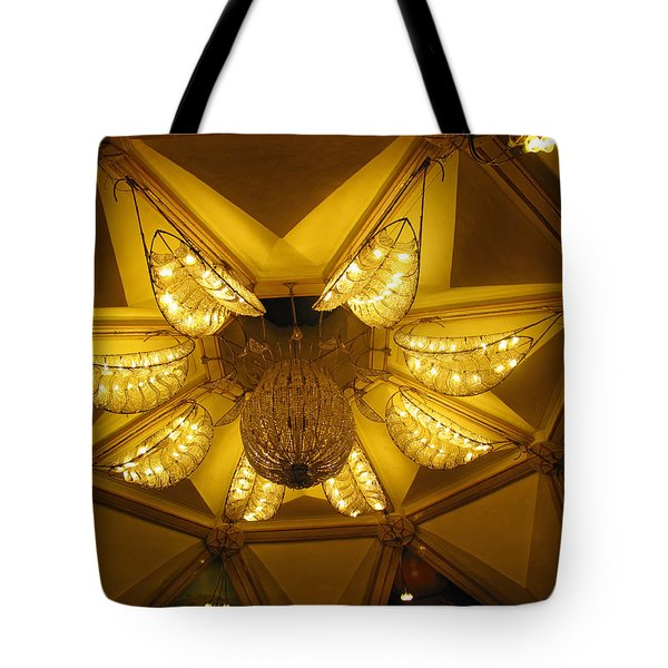 The Beautifully Lit Chandelier On The Ceiling Of The Iskcon Temple In Delhi Tote Bag by Ashish Agarwal