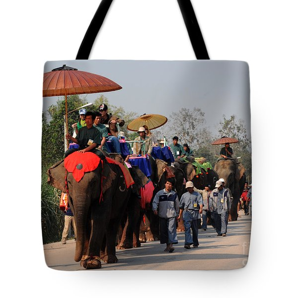 Tote Bag featuring the photograph The Elephant Parade by Vivian Christopher
