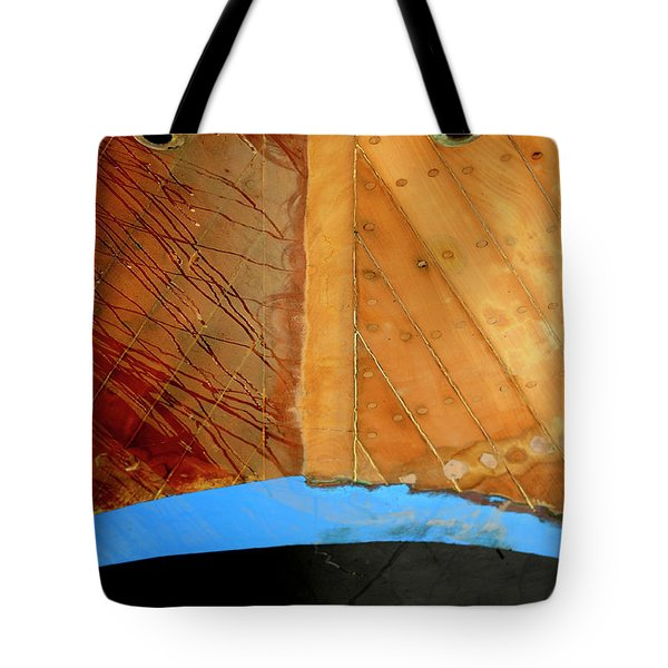 Tote Bag featuring the photograph The Face by Pedro Cardona