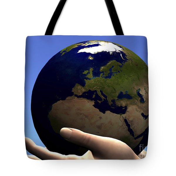 The Planet Earth Is Held In Caring Tote Bag by Corey Ford