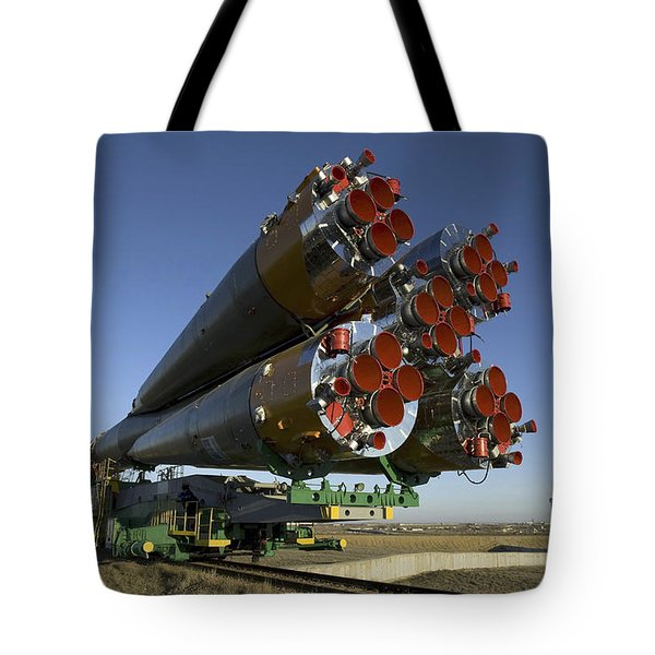 The Soyuz Rocket Is Rolled Tote Bag by Stocktrek Images