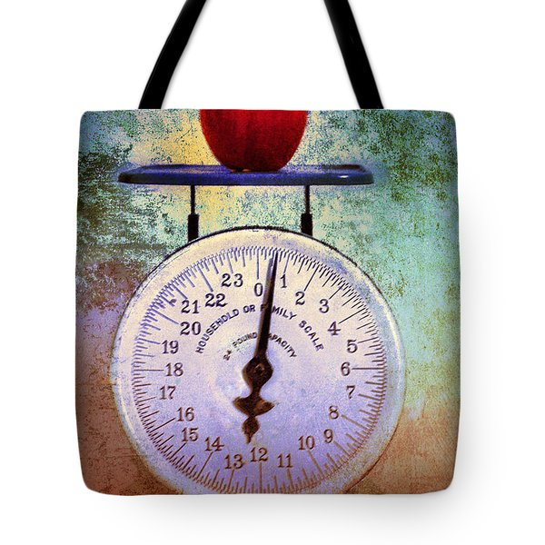 The Weight Of An Apple Tote Bag by Tara Turner