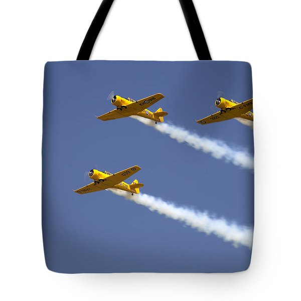 Three Yellow Harvards Flying In Unison Tote Bag