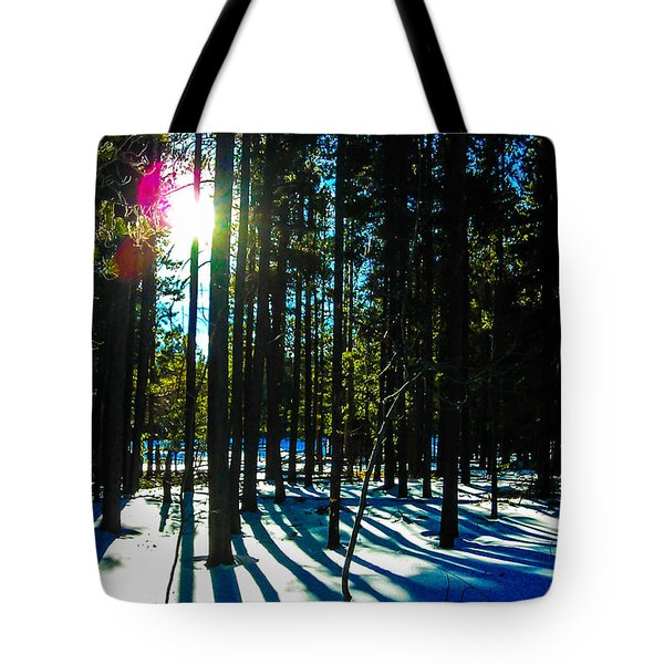 Tote Bag featuring the photograph Through The Trees by Shannon Harrington