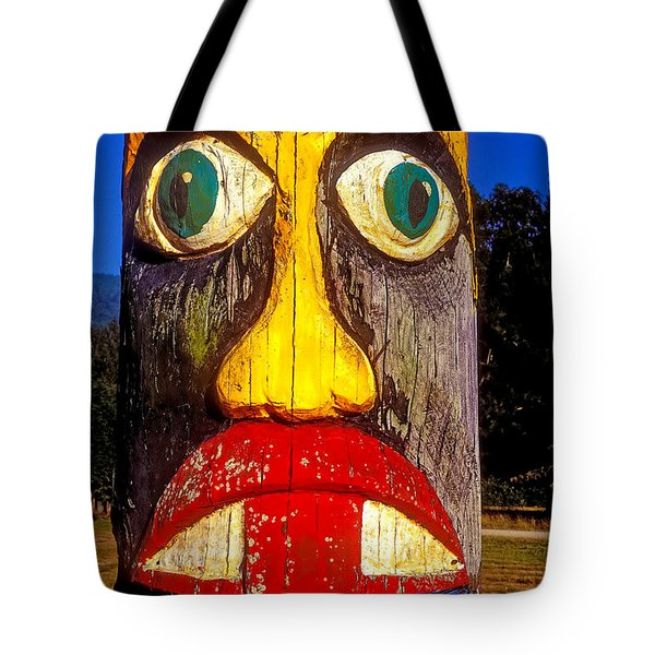 Totem Pole With Tongue Sticking Out Tote Bag by Garry Gay