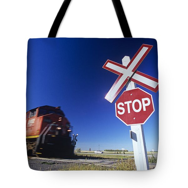 Train Passing Railway Crossing Tote Bag by Dave Reede