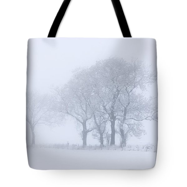 Trees Seen Through Winter Whiteout Tote Bag by John Short