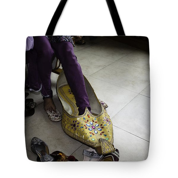 Tote Bag featuring the photograph Trying On A Very Large Decorated Shoe by Ashish Agarwal