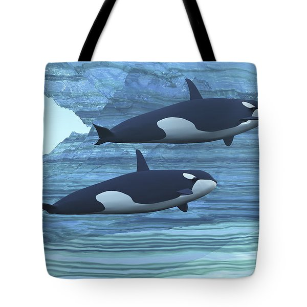 Two Killer Whales Swim Around Submerged Tote Bag by Corey Ford