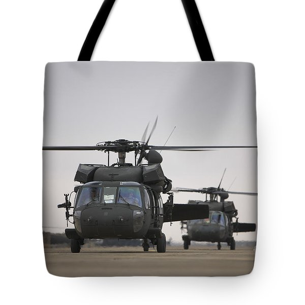 Two Uh-60 Black Hawks Taxi Tote Bag by Terry Moore