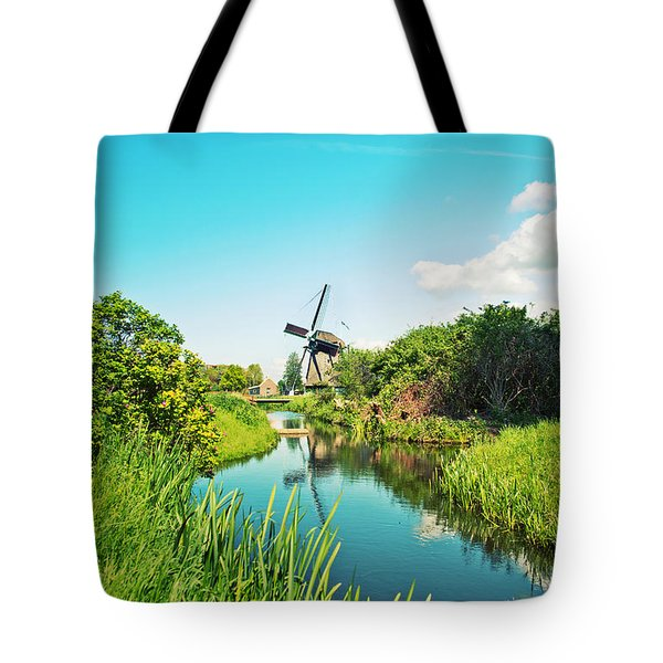 Tote Bag featuring the photograph Typical Dutch  Windmill by Ariadna De Raadt