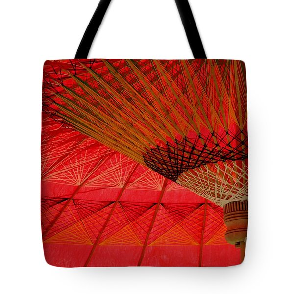 Tote Bag featuring the photograph Under The Umbrella by Nola Lee Kelsey