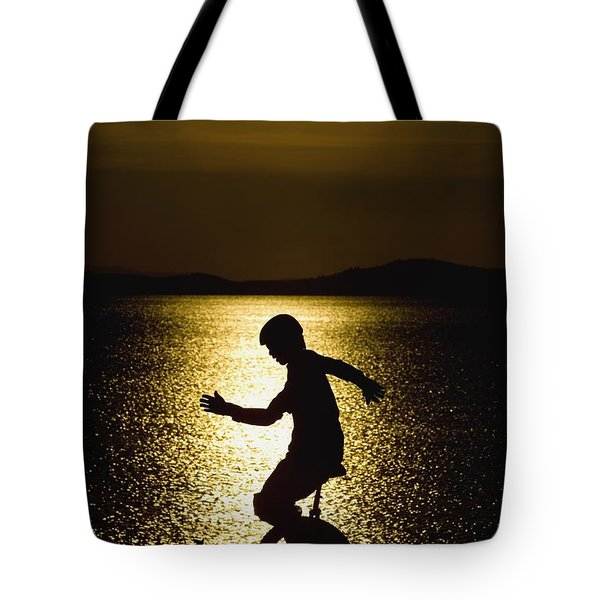 Unicycling Silhouette Tote Bag by Deddeda
