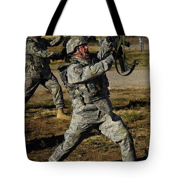 U.s. Air Force Soldier Practices Tote Bag by Stocktrek Images