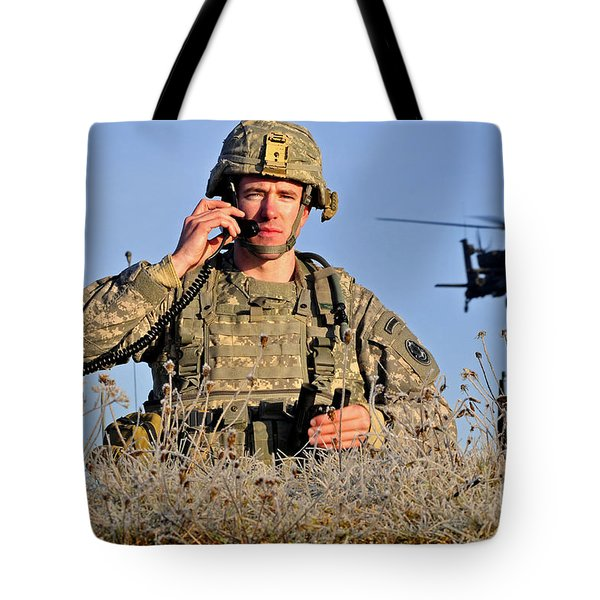 U.s. Army Captain Directs An Ah-64 Tote Bag by Stocktrek Images