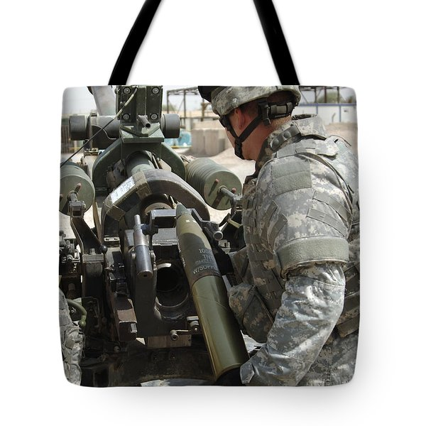 U.s. Army Soldier Loads A 105mm Tote Bag by Stocktrek Images